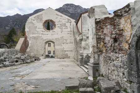 Ancient church of St. John the Baptist of the 14th century perched in Venzone, Friuli, Italy Sajtókép