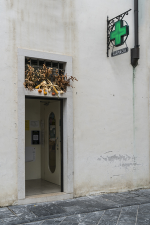 floral decorations on the houses in the center of Venzone, Friuli, Italy