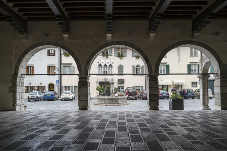 the portico of the medieval palace of the town hall in Venzone, Friuli, Italy