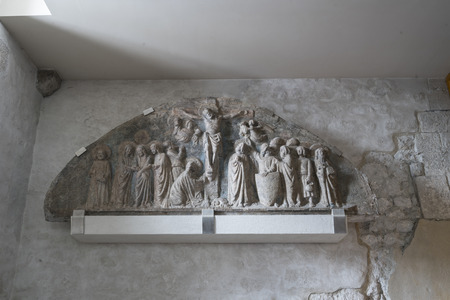 14th century stone lunette depicting the crucifixion kept in the church of Sant'Andrea Apostle in Ve ... Editorial