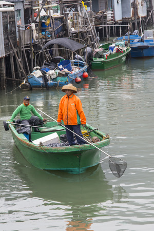fishing boats moored in the village of Tai O while selling fresh fish.
