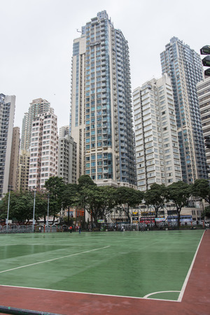 a playing field among the skyscrapers of Hong Kong