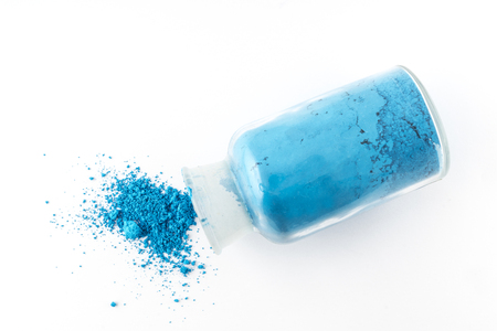 glass flask containing natural blue colored pigment powder