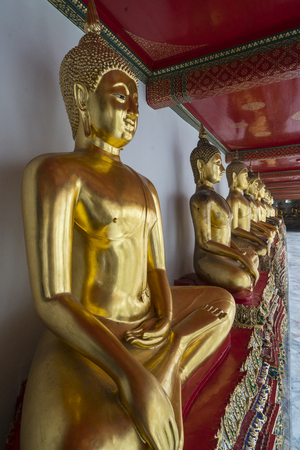 golden buddha statues in wat pho temple in bangkok thailand stock