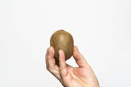 A kiwi held in a hand Stock Photo