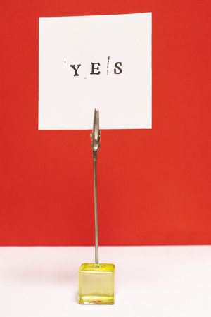 the word yes printed on a sheet of paper
