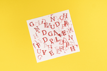 letters of the alphabet randomly printed on a sheet of paper Stock Photo
