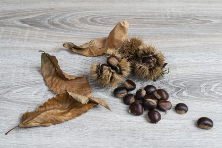some chestnuts on the wooden table