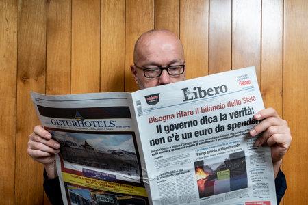 A man reads the Libero Italian newspaper