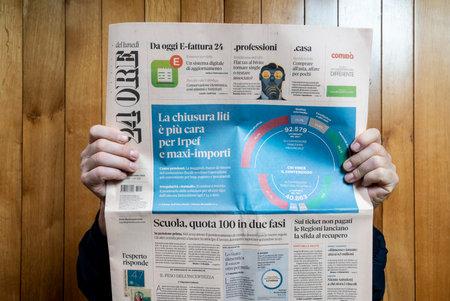 Aman reads The Il Sole 24 Ore Italian newspaper Editorial