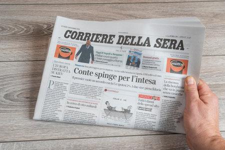 a View of the Corriere della Sera Italian newspaper on the table