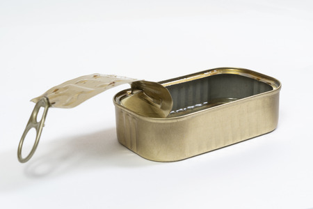 an empty tin of fish in oil