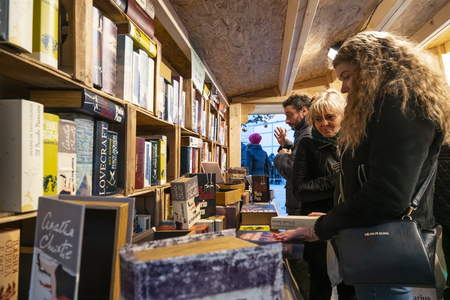 two women while they buy books in a bookstore
