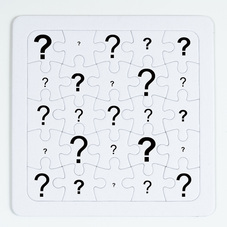a puzzle with white pieces with an question mark