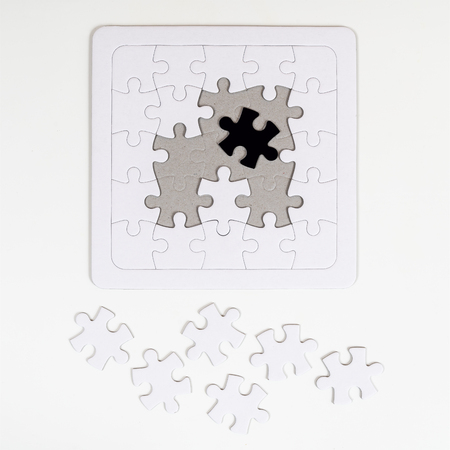 the incomplete puzzle with a black piece