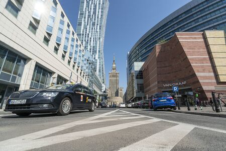 Warsaw, Poland. April 2019.   view of the Palace of Culture and Science among the modern buildings in the city center