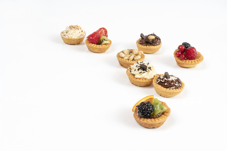 some mixed round pastries on a white surface Imagens