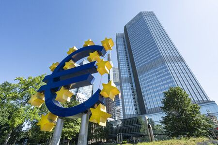 Frankfurt, Germany. July 2019.  the monument of the euro symbol in front of the Eurotorre building 報道画像