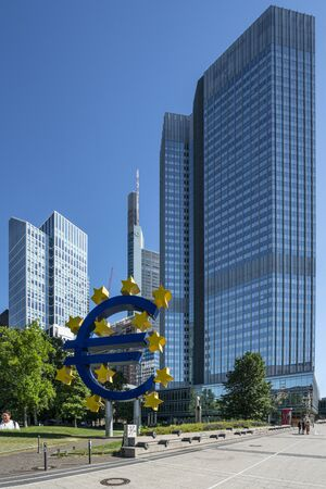 Frankfurt am Main, July 2019. A view of the Euro symbol in front of the Eurotower skyscraper