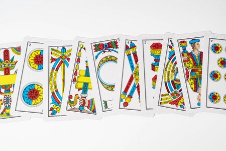 some Cards for the briscola game on a white table Stockfoto