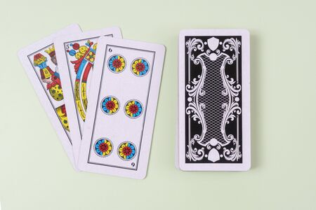 front and rear of  Cards for the briscola game on a white table