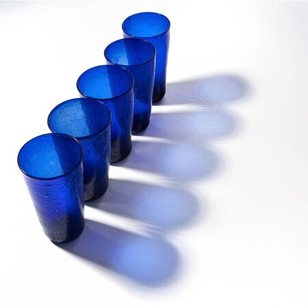 Some blue glasses on a white surface