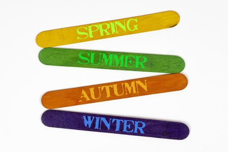 the four seasons write on coloured wooden slats