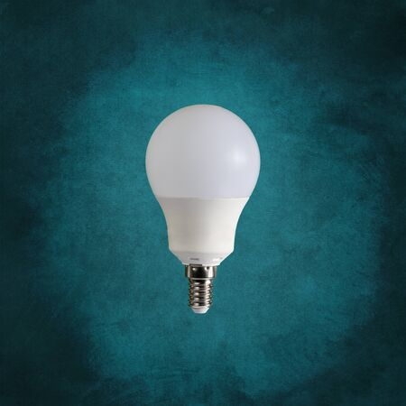a light bulb isolated in front of an antique background