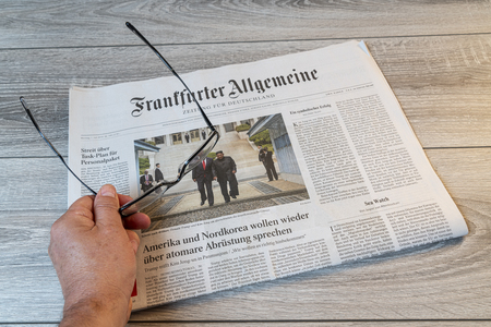 Frankfurt am Main, Germany. June 29, 2019.  The lecture of the Frankfurter Allgemeine german newspaper on a wooden table