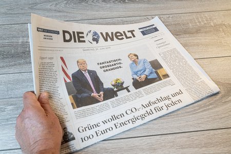 Frankfurt am Main, Germany. June 29, 2019.  The lecture of the Die Welt german newspaper on a wooden table