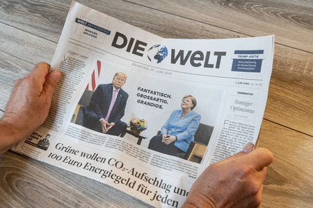 Frankfurt am Main, Germany. June 29, 2019. The lecture of the Die Welt german newspaper on a wooden table Editorial