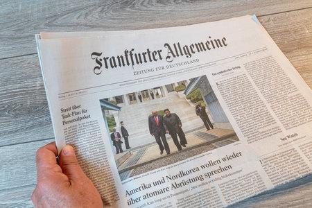 Frankfurt am Main, Germany. June 29, 2019.  The lecture of the Frankfurter Allgemeine german newspaper on a wooden table