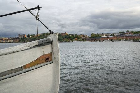 Stockholm, Sweden. September 2019.  the bow of an old wooden boat with a view of the city in the background Sajtókép