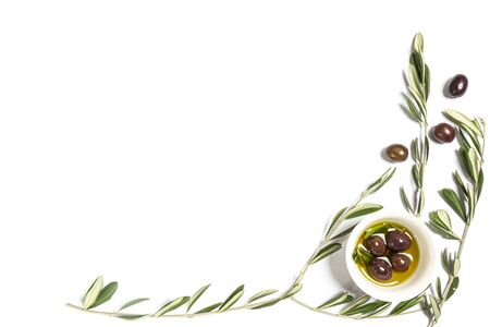 Olive oil and olives on a white surface with some Olive branches Stock fotó