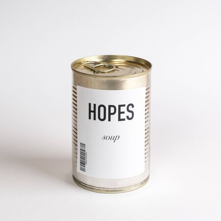 a jar containing hopes concept soup on a white surface Stock fotó
