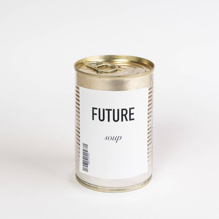 a jar containing future soup on a white surface