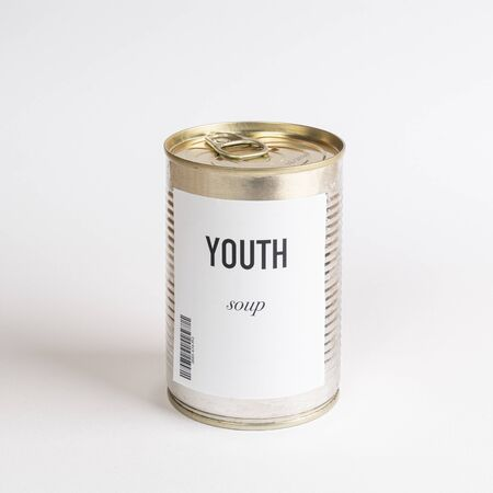 a jar containing youth concept soup on a white surface Stock fotó