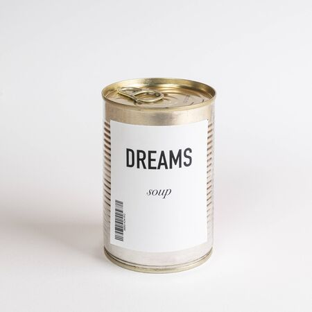 a jar containing dreams soup on a white surface Stock fotó