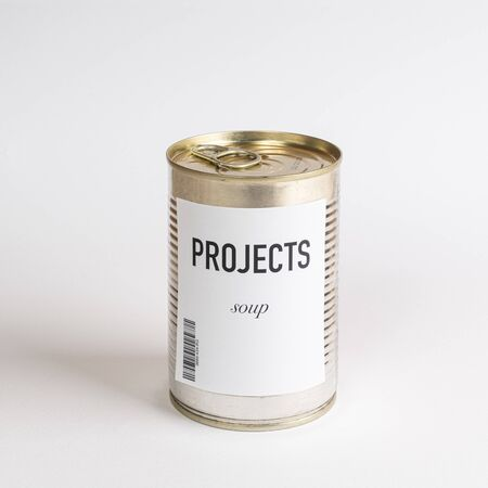 a jar containing projects concept soup on a white surface Stock fotó