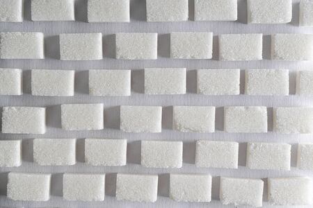 the background pattern formed with sugar cubes 写真素材
