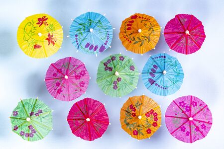 some small Japanese umbrellas on a blue surface 写真素材