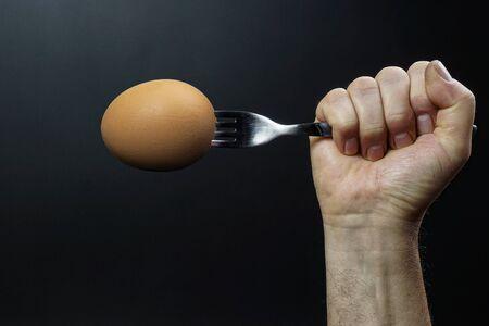 an egg impaled on a fork