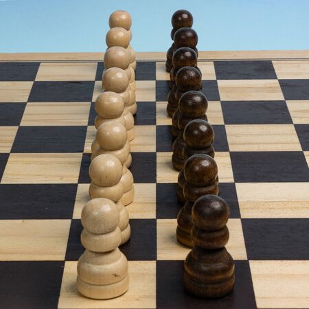 the two opposing pawns line-up on the chessboard 写真素材