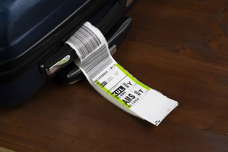 a baggage tag embarked on a plane of the KLM airline Editorial