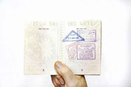 an internal page of the Italian passport with some immigration stamps