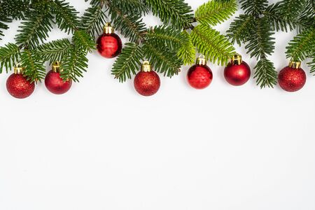 a Christmas composition on a white surface