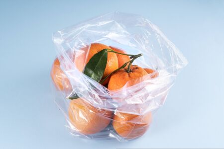Some tangerines in a plastic bag