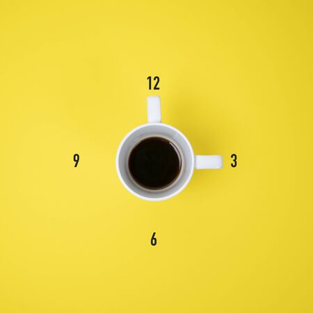 A cup of coffee forming a clock Standard-Bild