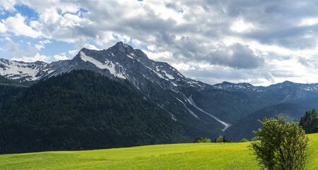 a panoramic view of Monte Bivera from the Sauris di Sopra village, Italy Stok Fotoğraf - 147582941