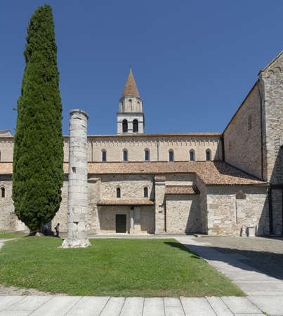 Aquileia, Italy. July 5, 2020 .a Roman column in front of the basilica of Aquileia, Italy